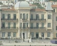 Zoom out from large harbourside building on Spetses SD Footage