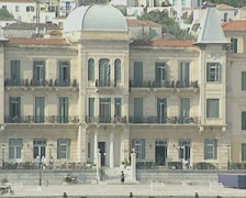 Zoom out from large harbourside building on Spetses - stock footage
