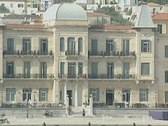 Stock Video Footage of Zoom out from large harbourside building on Spetses