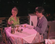 Couple dining together outside Stock Footage