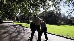 People walking in the Botanic Gardens, Melbourne, Australia Stock Footage