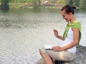 A young woman chatting on laptop, outdoors Stock Footage
