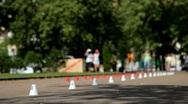 Roller skate slalom between traffic cones. Defocus Stock Footage