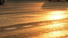 Cars go on the road at sunset Stock Footage