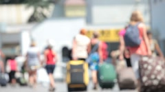 People with suitcases walk along the station platform Stock Footage