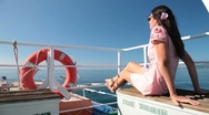 Woman resting on the deck Stock Footage