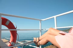 Girl relaxing on deck of  yacht Stock Footage