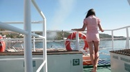 Young woman relaxing on the deck of  ship Stock Footage