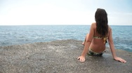 Young girl in a bikini on pier Stock Footage