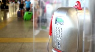 Telephone apparatus weighs in airport people walk around Stock Footage