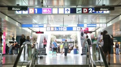Passengers in a hurry near four escalators Stock Footage