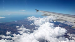 Clouds under aircraft wing Stock Footage