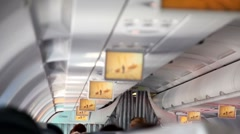 Aircraft cabin, under ceiling hung displays and show extrime sport video - stock footage