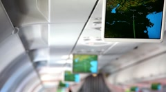 Aircraft cabin, under ceiling hung displays and show information about flight Stock Footage