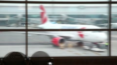 Tug pulling Czech Airlines plane at airport, view from window of airport edifice Stock Footage