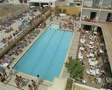 High view of swimming pool and busy area Footage