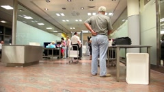 Few people prepare to move throught airport customs Stock Footage