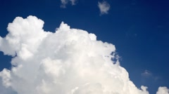 Dense clouds flew in the sky lighted sunshine Stock Footage