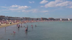 Weymouth beach at the height of summer - wide shot - stock footage