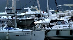 Luxury yachts and boats docked in the marina Stock Footage