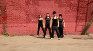 Stock Video Footage of Dance team of four girls start dance synchronously, then fall down