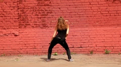 Curls girl stand back to camera and dance, then turn around Stock Footage