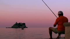 Fisherman on the sea catching fish from pier Stock Footage