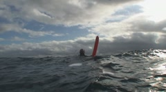 Scubadiver at surface carries a safety buoy Stock Footage