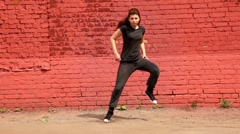 Girl in black clothing dance active in modern style Stock Footage