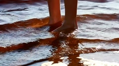Girls feet in water - stock footage