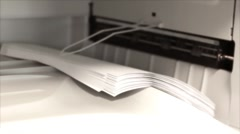 Office copier copying stack of paper - stock footage