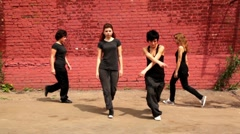 Four girls start to dance synchronously but one of them make mistake and they Stock Footage