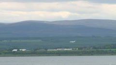 Plane Landing in Scotland Stock Footage