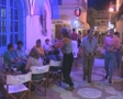 Busy nightlife street with bars and neon signs Footage