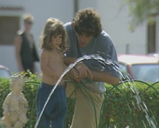 Close up of father and child watching fountain - stock footage