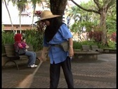 Stock Video Footage of Asian Lady Sweeping Walkway
