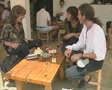People sitting round table talking and laughing SD Footage
