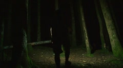Man Walking in Dark Scary Forest Stock Footage