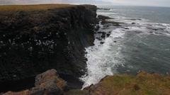 Sloping Basalt Cliff Atlkantic ocean crashing waves, Arnarstapi Iceland Stock Footage