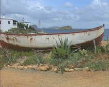 Stock Video Footage of Rusting boat at side of path