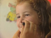 Close up of little girl getting her face painted Stock Footage