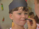Close up of little boy getting her face painted Stock Footage