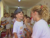 Little boy getting his face painted Stock Footage