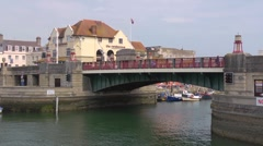Time lapse of the lifting bridge at Weymouth opening.  Boats are allowed through Stock Footage