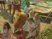 Stock Video Footage of Close up of children being led round pool by children's entertainer
