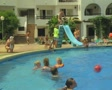 Man going down small slide into pool Footage