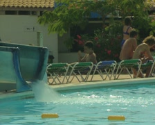 View of bottom of waterslide and poolside - stock footage