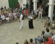 Pair performing traditional dance for audience SD Footage
