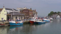 The old harbour and waterfront at Weymouth, Dorset - GV Stock Footage