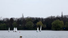 Sailing Boats in a Park Lake, Yachting, Competition, Cloudy Day, Water Sport - stock footage